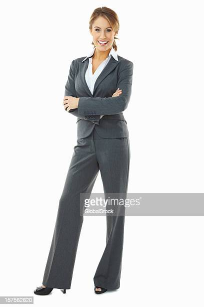 Confident business woman standing isolated against white