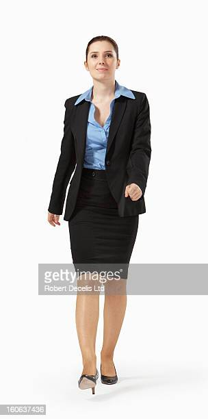 Confident business woman strolling along