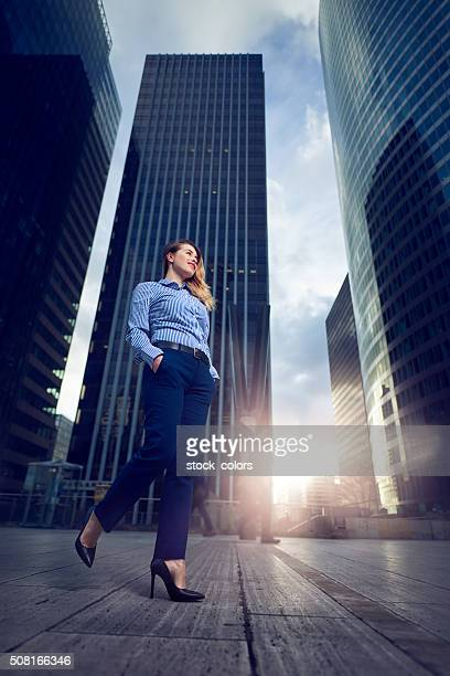 confident business woman walking to her office