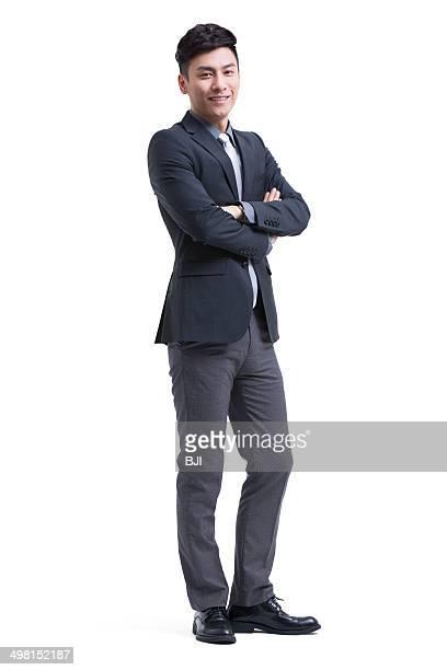 Confident businessman arms crossed