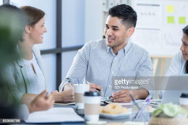 Confident businessman leads meeting