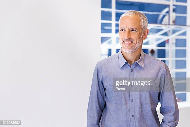 Confident businessman looking away in office