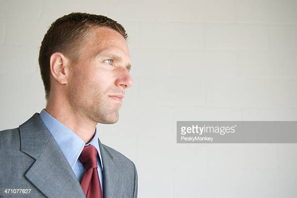 Confident Businessman Looking in Profile to Copy Space