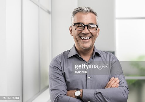 Confident businessman posing in the office : Stock Photo
