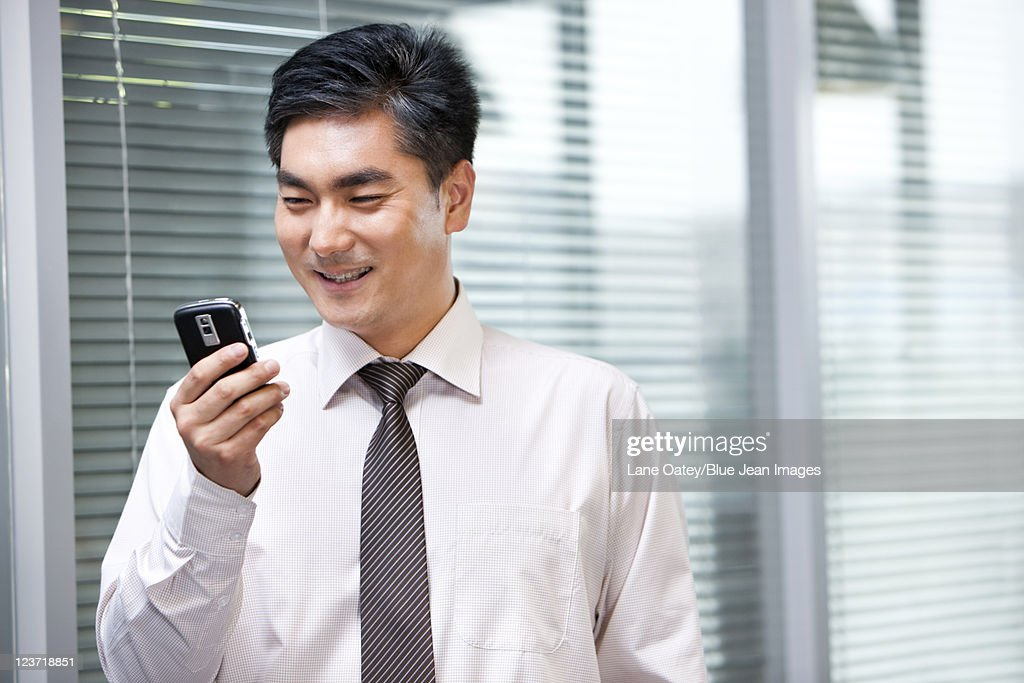 Confident Businessman Reading Text Message : Stock Photo