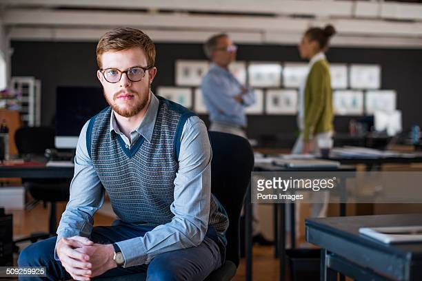 Confident businessman sitting at creative office