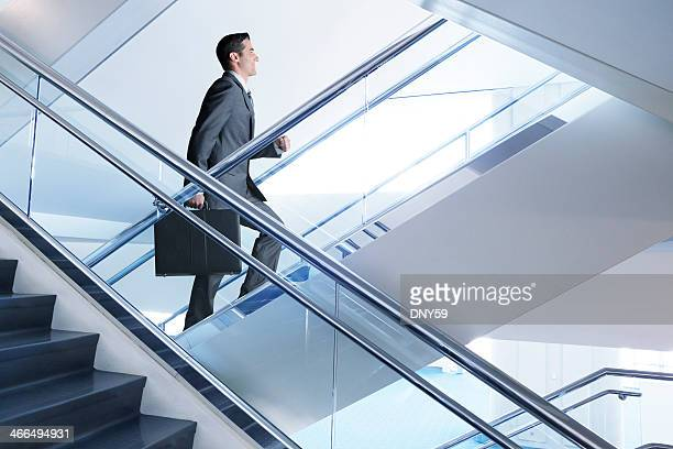 Confident businessman walking up flight of stairs