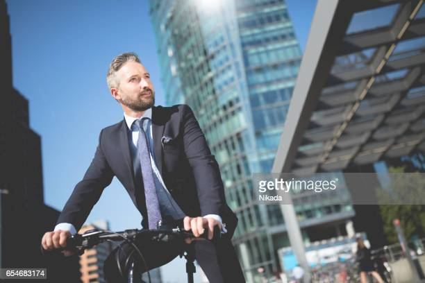 Confident Businessman with bicycle in Berlin