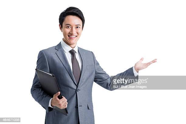 Confident businessman with portfolio