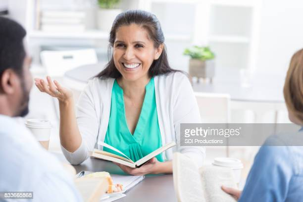 Confident businesswoman discusses something during meeting