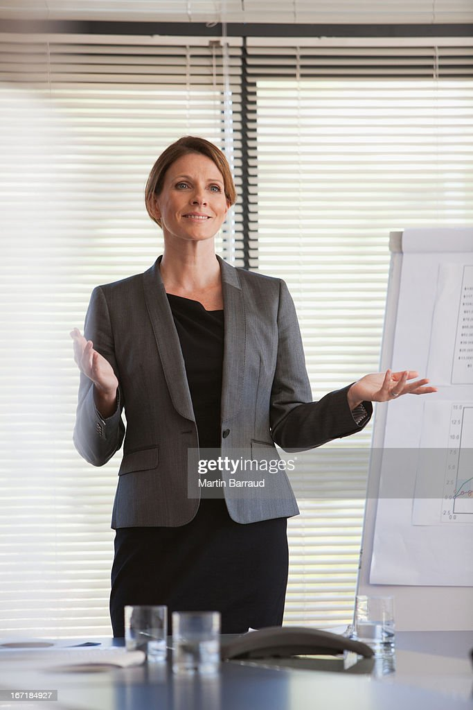 Confident businesswoman giving presentation : Stock Photo