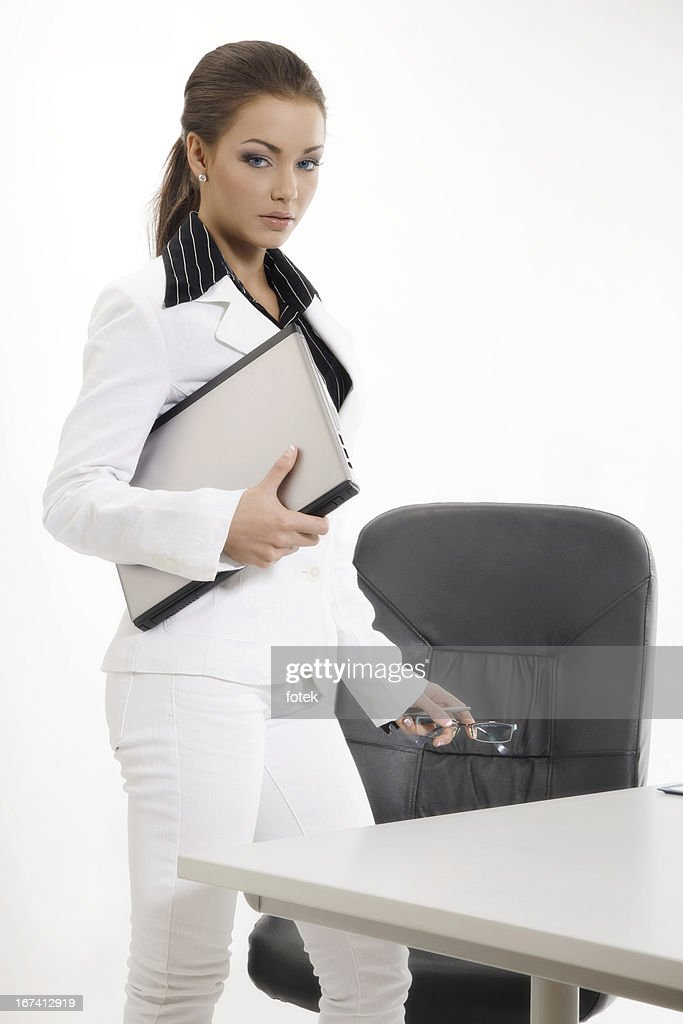 Confident businesswoman holding laptop : Stock Photo