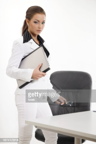 Confident businesswoman holding laptop : Stockfoto