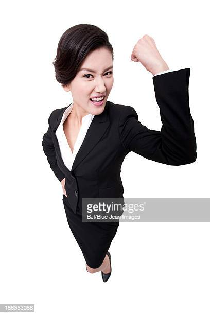 Confident businesswoman punching the air