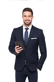 Young confident caucasian businessman holding digital tablet, toothy smile, isolated on white