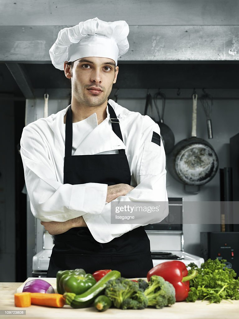 Confident chef in a kitchen : Stock Photo
