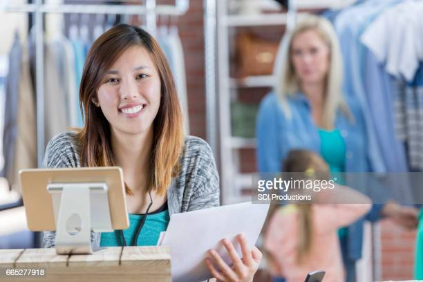 Confident clothing store manager