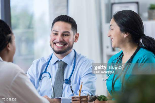 Confident doctor and nurse meet with patient