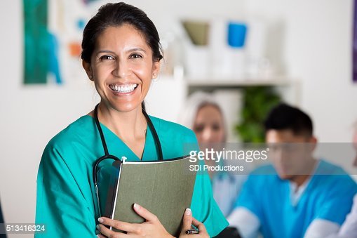 Confident doctor in medical staff meeting