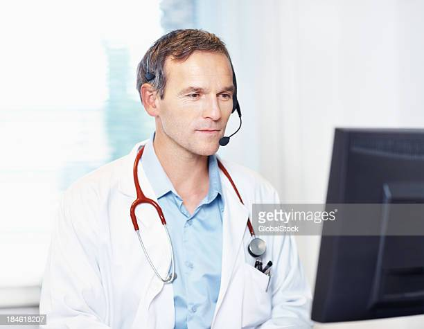 Confident doctor with headset