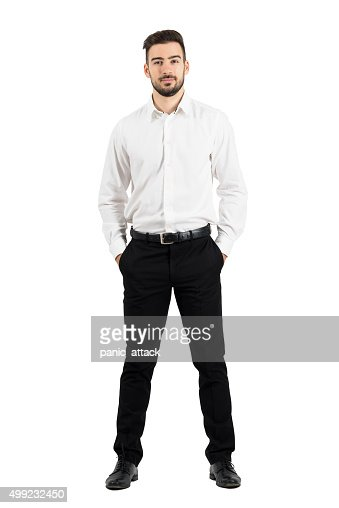Confident elegant business man with hands in pockets : Stock Photo