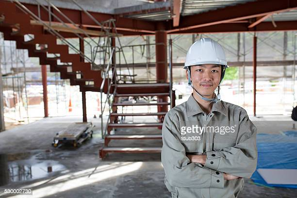 Confident engineer at a construction project