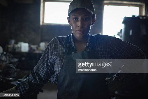 Confident female blacksmith : Stock Photo