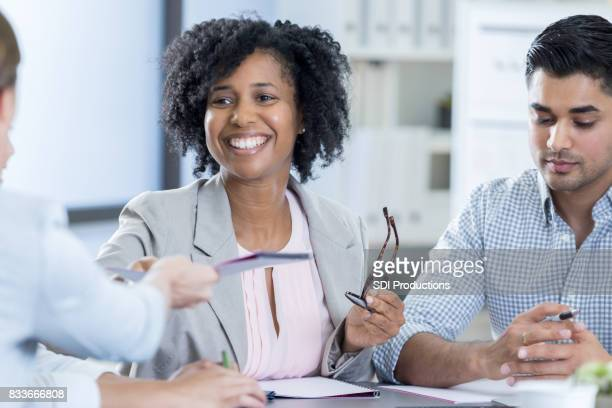 Confident female CEO leads staff meeting