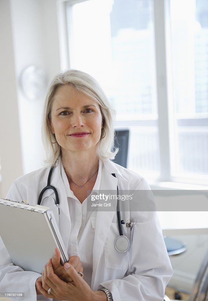 Confident female doctor : Stock Photo