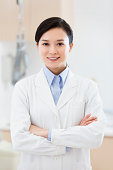 Confident female doctor with arms crossed