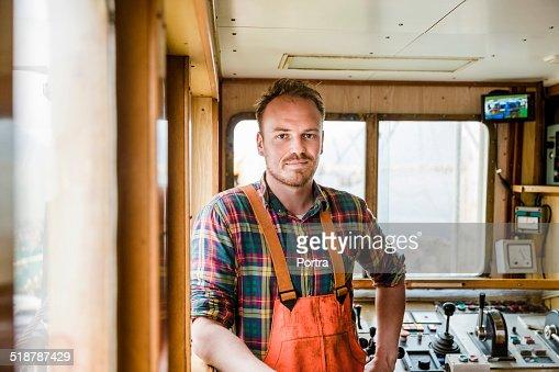 Confident fisherman in fishing boat
