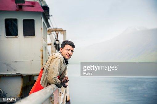 Confident fisherman on fishing boat