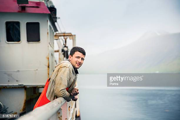 Confident fisherman on fishing boat