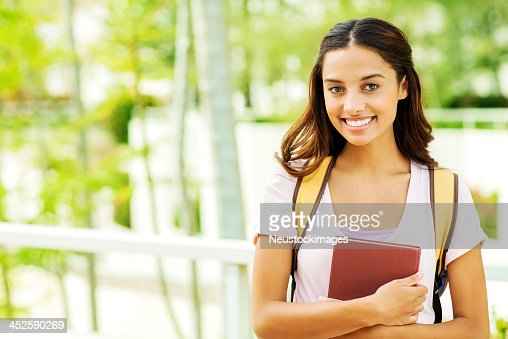 Confident Girl With Book On University Campus
