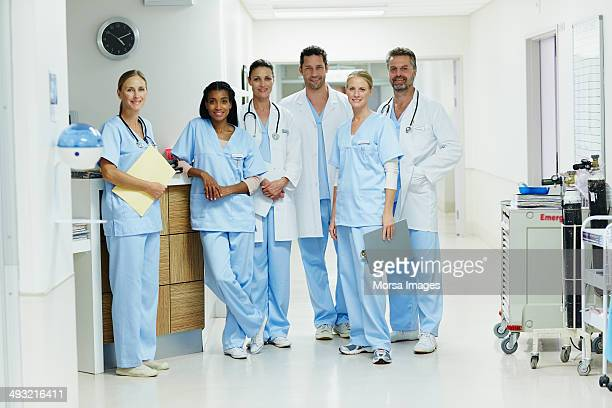 Confident healthcare workers standing in hospital