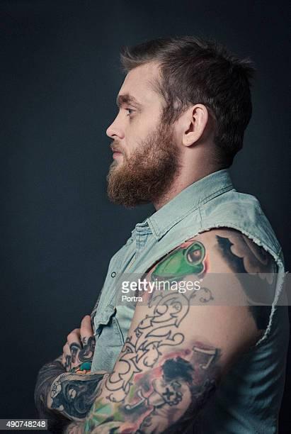 tattoo mann arm stock fotos und bilder getty images. Black Bedroom Furniture Sets. Home Design Ideas