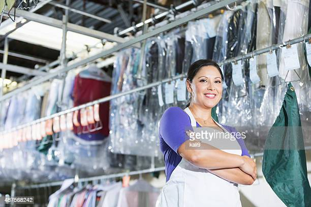 Confident Hispanic woman in her dry cleaning store