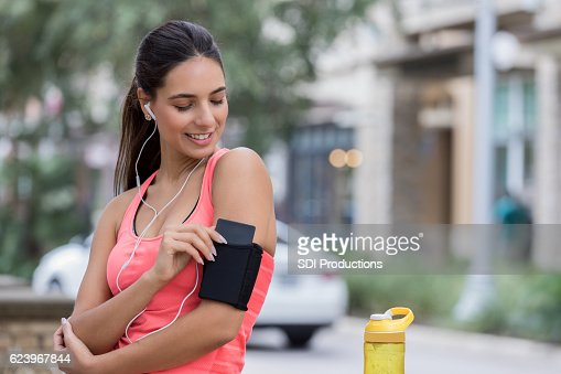 Confident Hispanic woman prepares for run