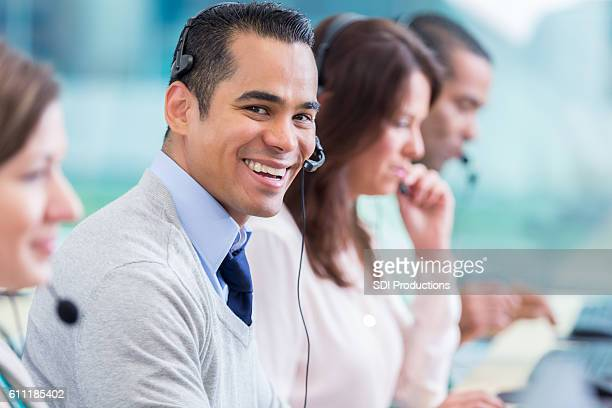 Confident IT support person in call center