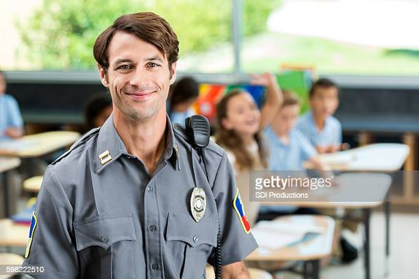 Confident law enforcement officer in school classroom