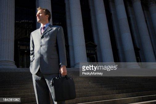Confident Lawyer Businessman Standing Outdoors on Courthouse Steps