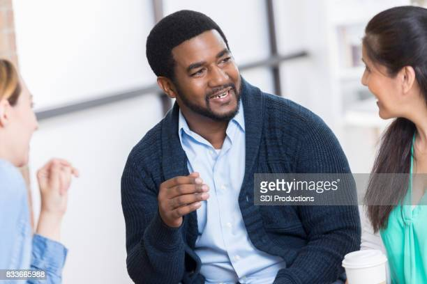 Confident male counselor leads support group