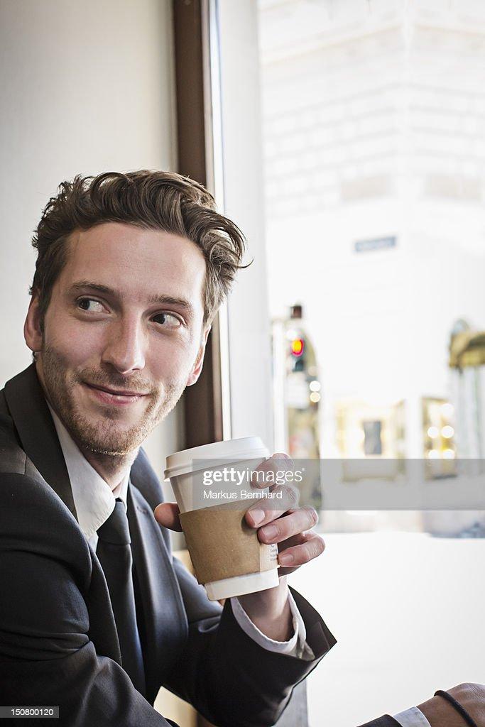 Confident man enjoying coffee to go. : Stock Photo