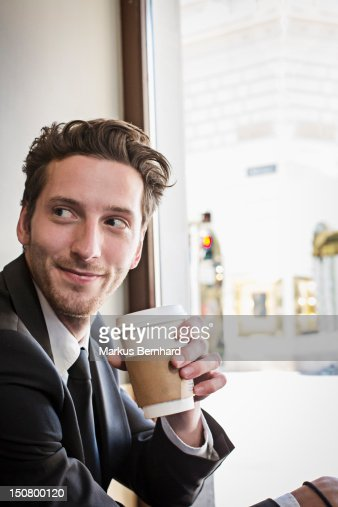 Confident man enjoying coffee to go. : ストックフォト