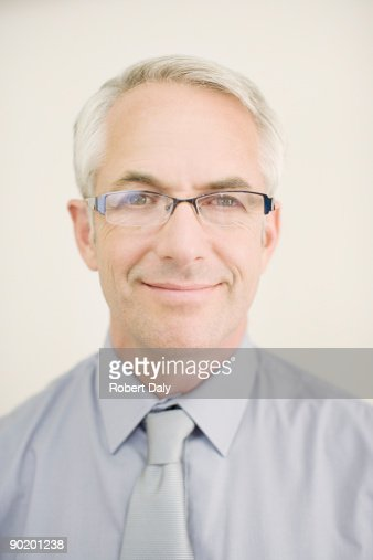 Confident man in eyeglasses smiling