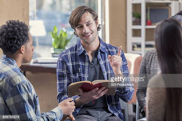 Confident man participates in a Bible study discussion group