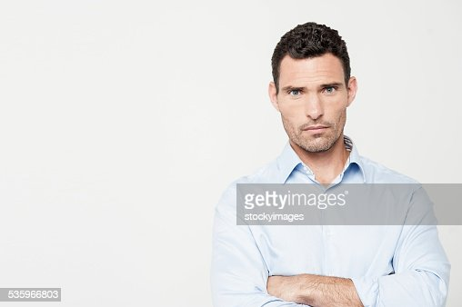 Confident man posing over white : Stock Photo