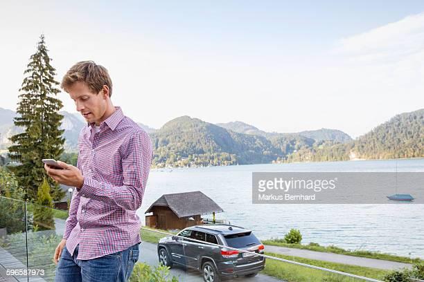 Confident man reading text message
