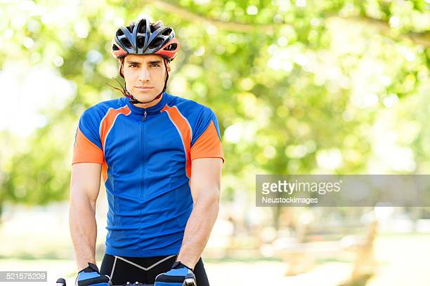 Confident Man Riding Bicycle At Park