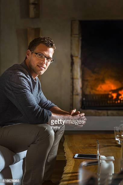 Confident man sitting in resort